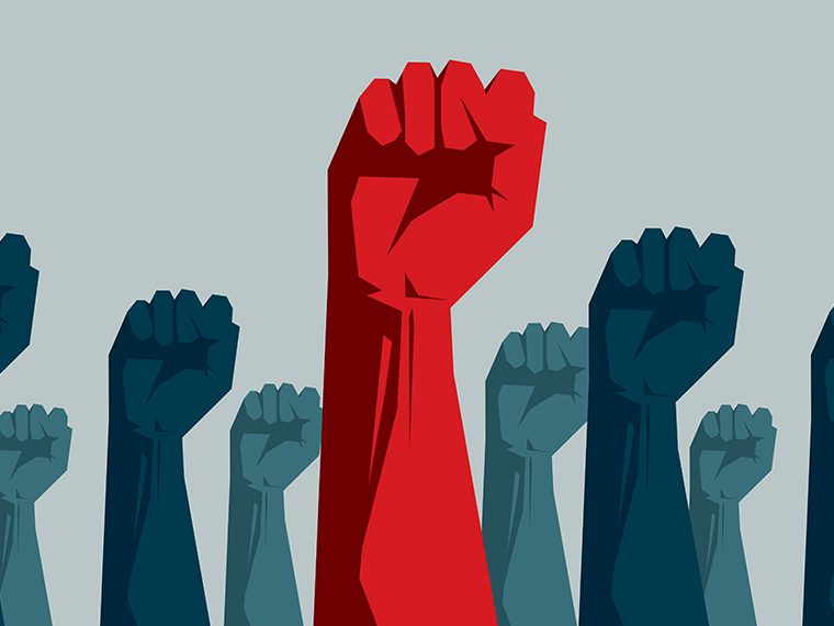 Raised fists with one in red