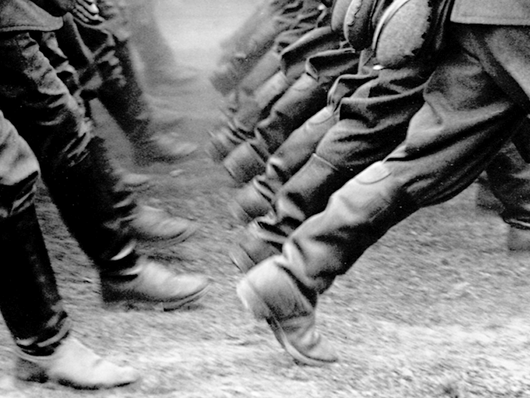 Monochrome photo of soldiers marching