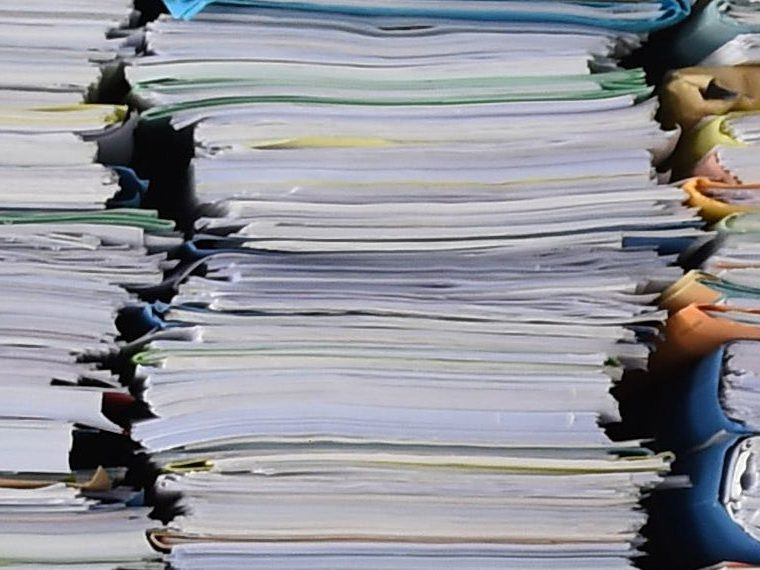 Stack of papers in folders