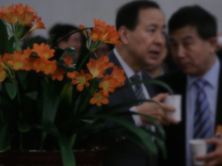 Chinese investors having a discussion