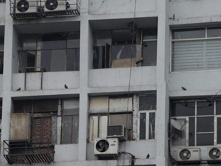 Building facade with old air conditioners