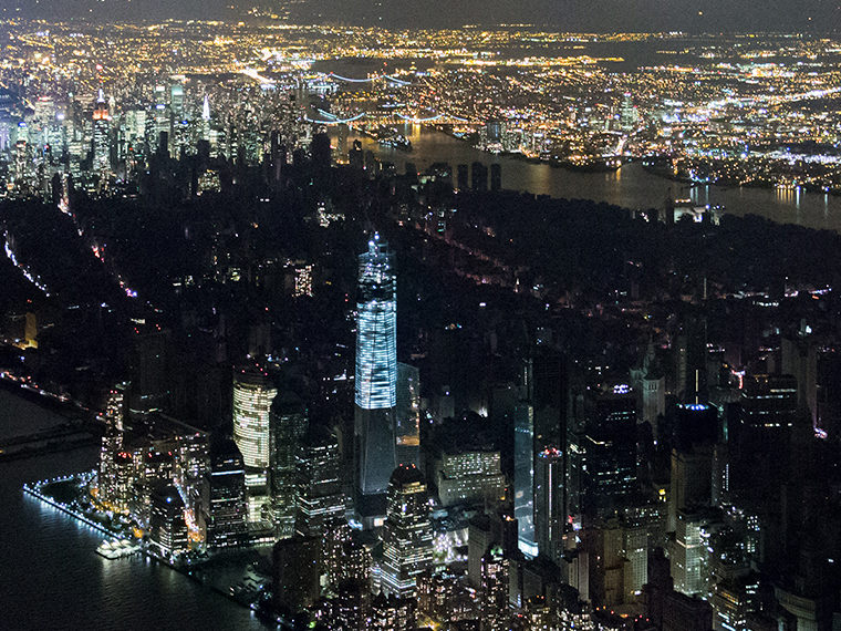 A city electrical blackout from above at night