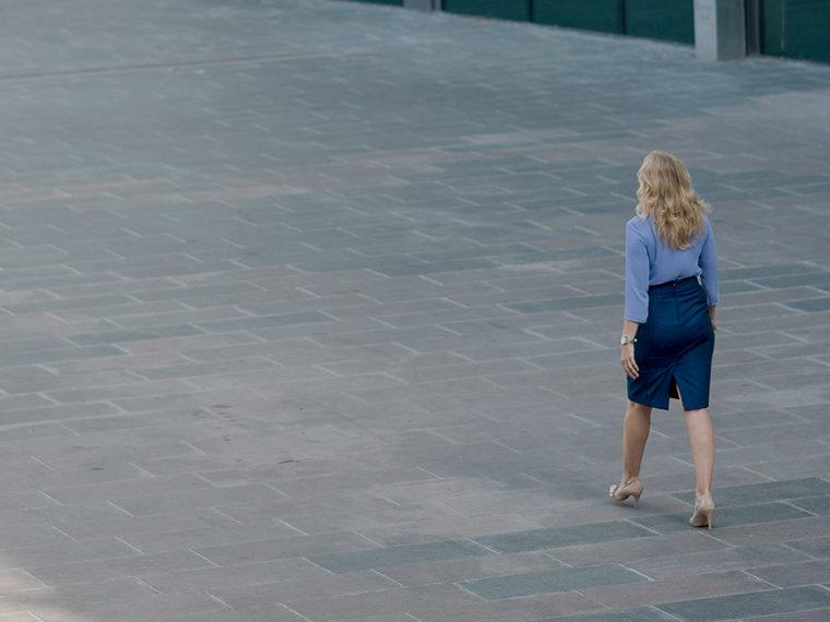 Woman walking through a courtyard