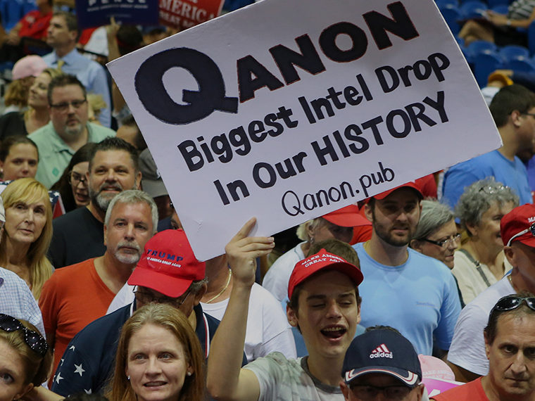Qanon supporters in a crowd