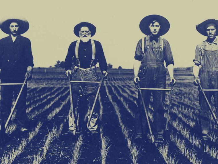 Sepia photo of four farmers