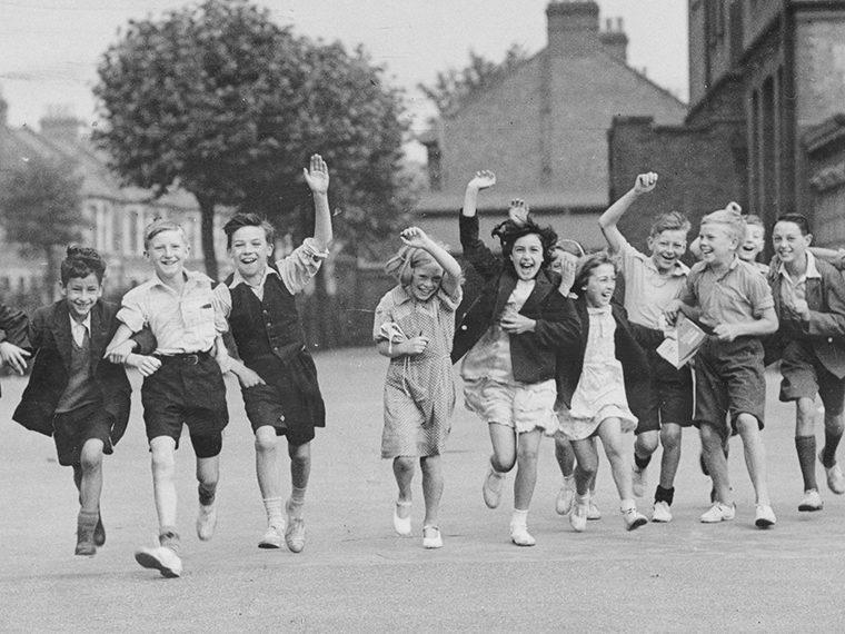 Monochrome picture of children cheering