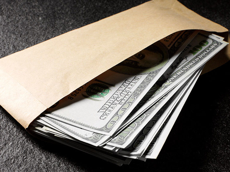 Stack of money in a brown envelope