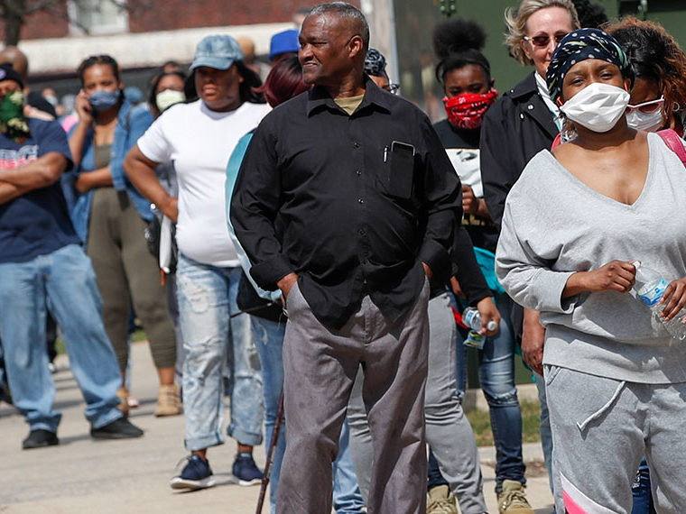People standing in line with face masks