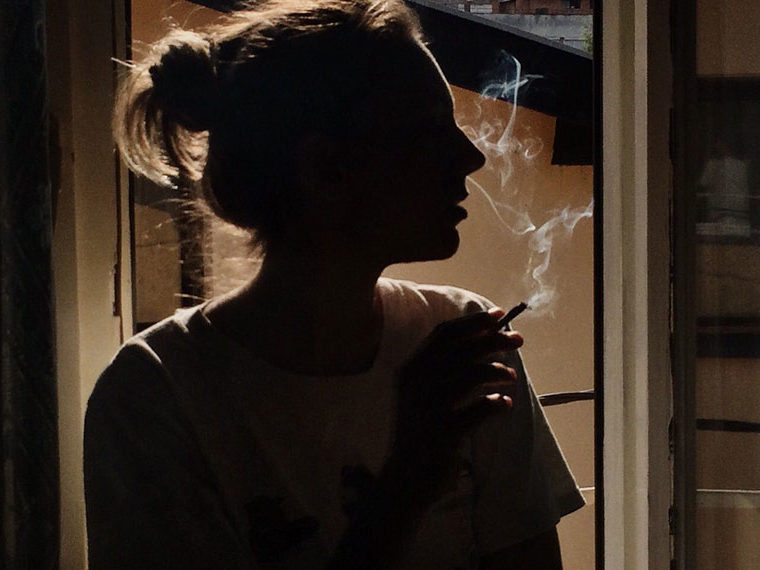 Silhouette of female smoker