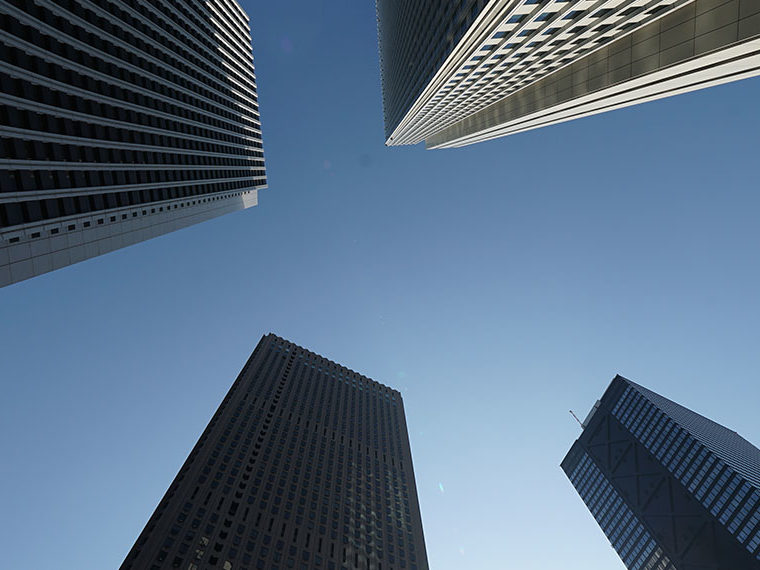 Tall buildings from the perspective of a person looking up