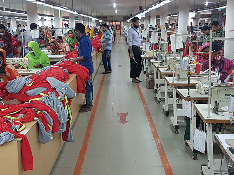 Workers in a garment factory sewing