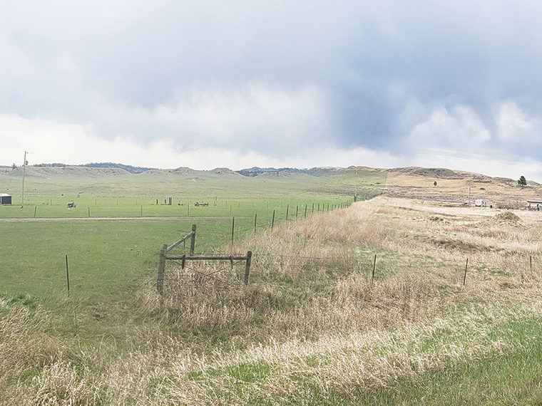 A farm on the prairie with one side dry