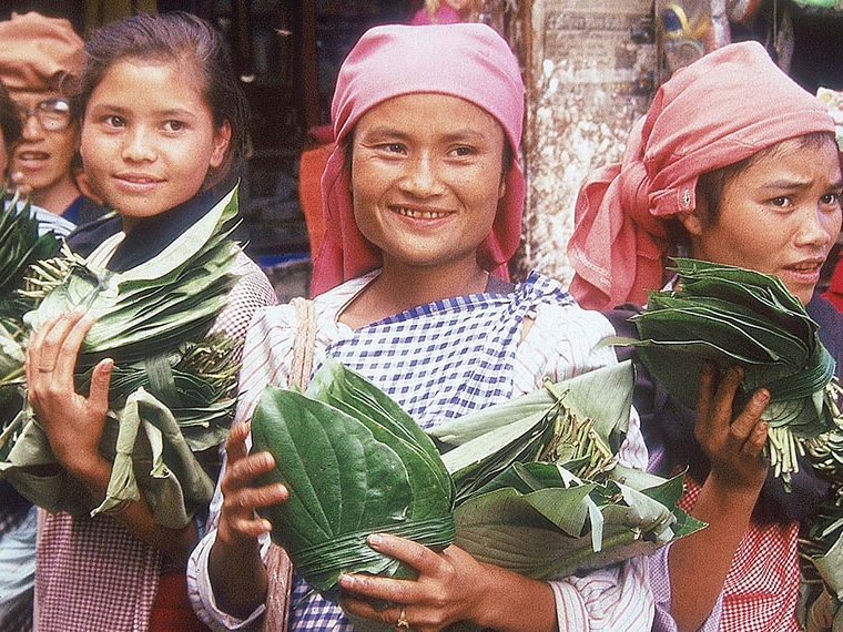 Khasi Women holding vegetables and smiling