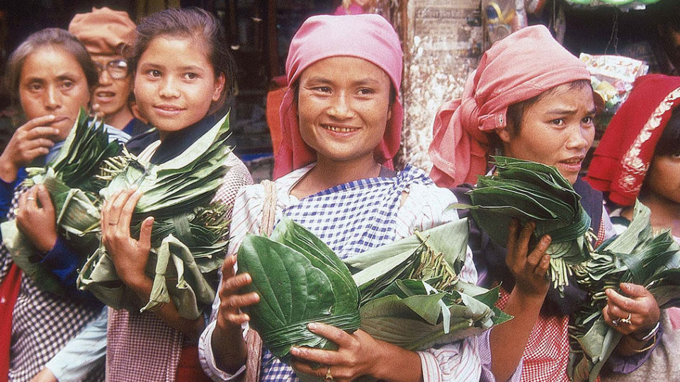 Khasi Women holding vegetables and smiling