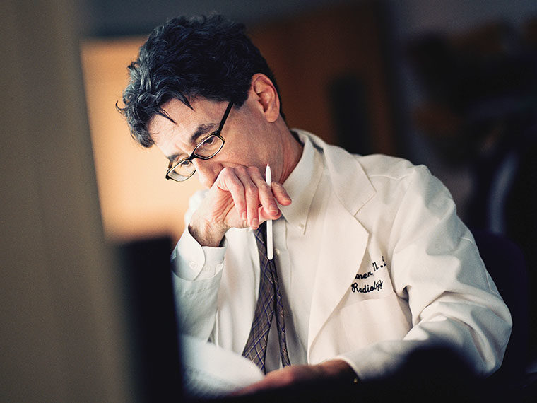 Doctor reading through paperwork